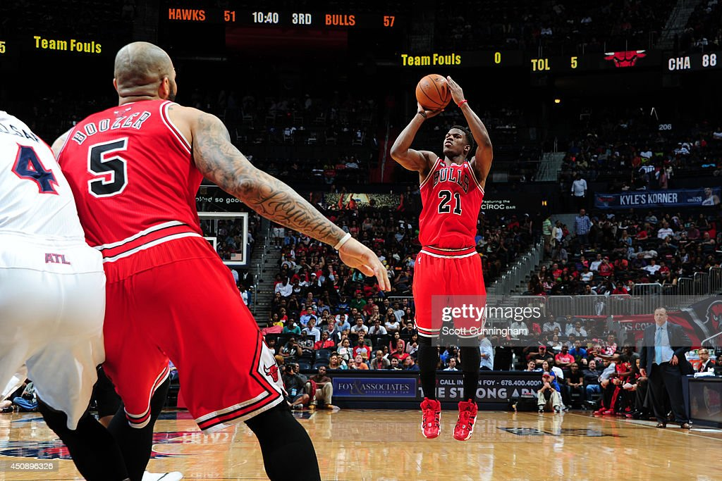 <a gi-track='captionPersonalityLinkClicked' href=/galleries/search?phrase=Jimmy+Butler+-+Basketball+Player&family=editorial&specificpeople=9860567 ng-click='$event.stopPropagation()'>Jimmy Butler</a> #21 of the Chicago Bulls shoots against the Atlanta Hawks on April 2, 2014 at Philips Arena in Atlanta, Georgia.