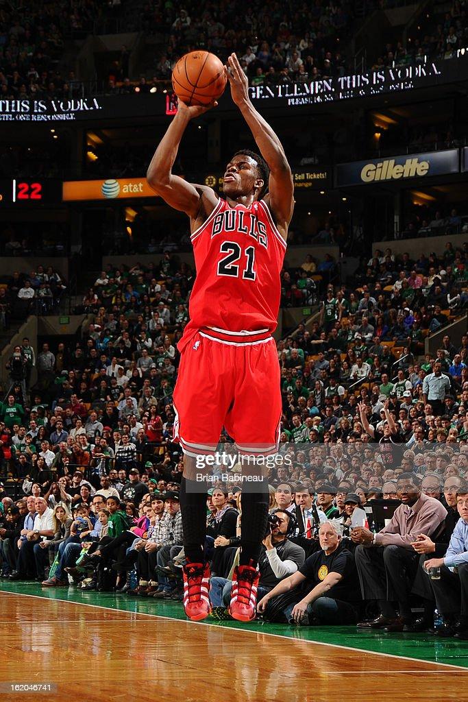 Jimmy Butler #21 of the Chicago Bulls shoots against the Boston Celtics on February 13, 2013 at the TD Garden in Boston, Massachusetts.