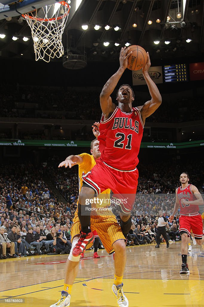 Jimmy Butler #21 of the Chicago Bulls shoots against the Golden State Warriors on March 15, 2013 at Oracle Arena in Oakland, California.