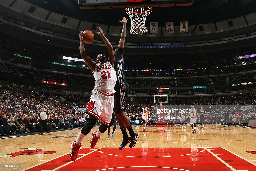 Jimmy Butler #21 of the Chicago Bulls shoots against the Minnesota Timberwolves on January 27, 2014 at the United Center in Chicago, Illinois.