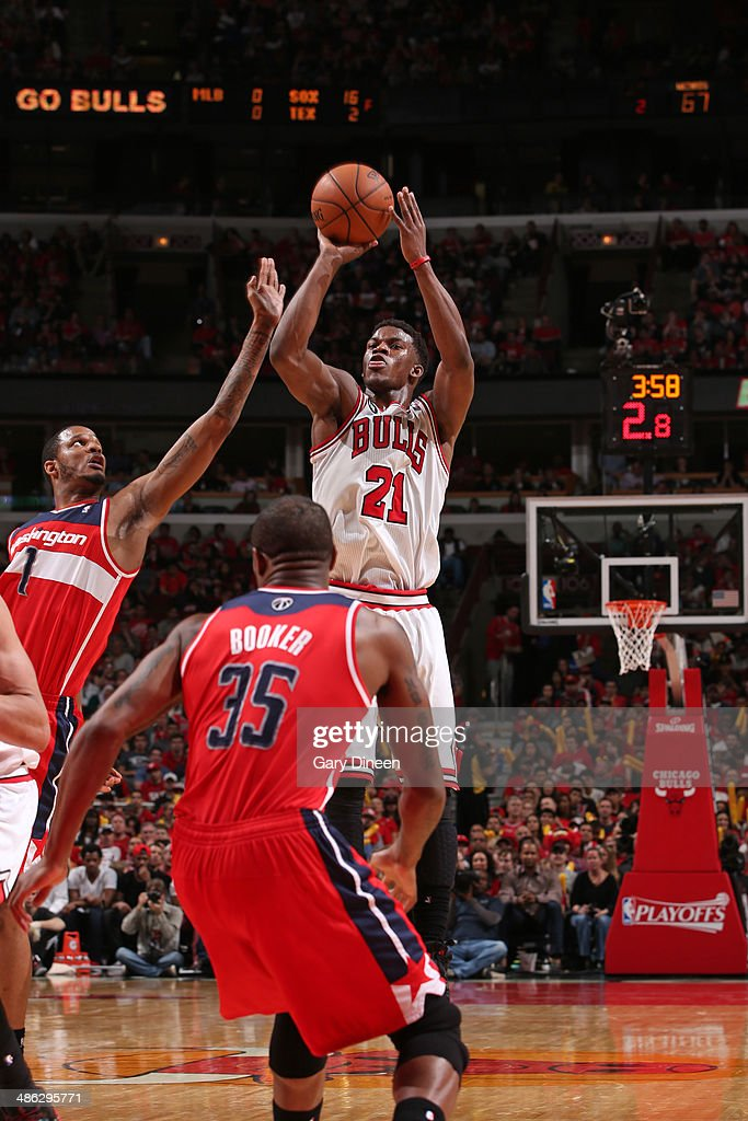 <a gi-track='captionPersonalityLinkClicked' href=/galleries/search?phrase=Jimmy+Butler+-+Basketball+Player&family=editorial&specificpeople=9860567 ng-click='$event.stopPropagation()'>Jimmy Butler</a> #21 of the Chicago Bulls shoots against the Washington Wizards during Game 1 of the Eastern Conference Quarterfinals on April 20, 2014 at the United Center in Chicago, Illinois.