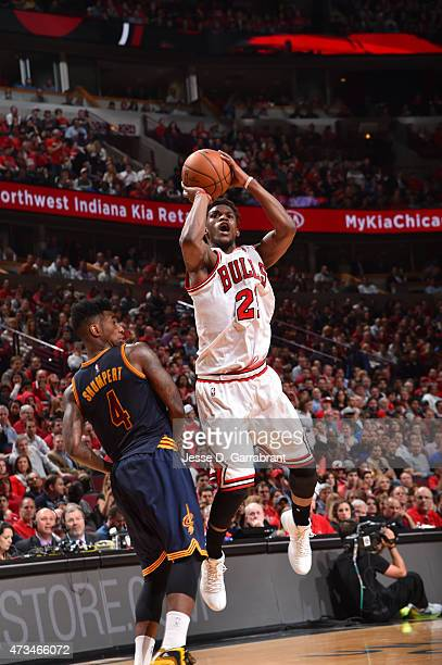 Jimmy Butler of the Chicago Bulls shoots the ball against the Cleveland Cavaliers at the United Center During Game Six of the Eastern Conference...