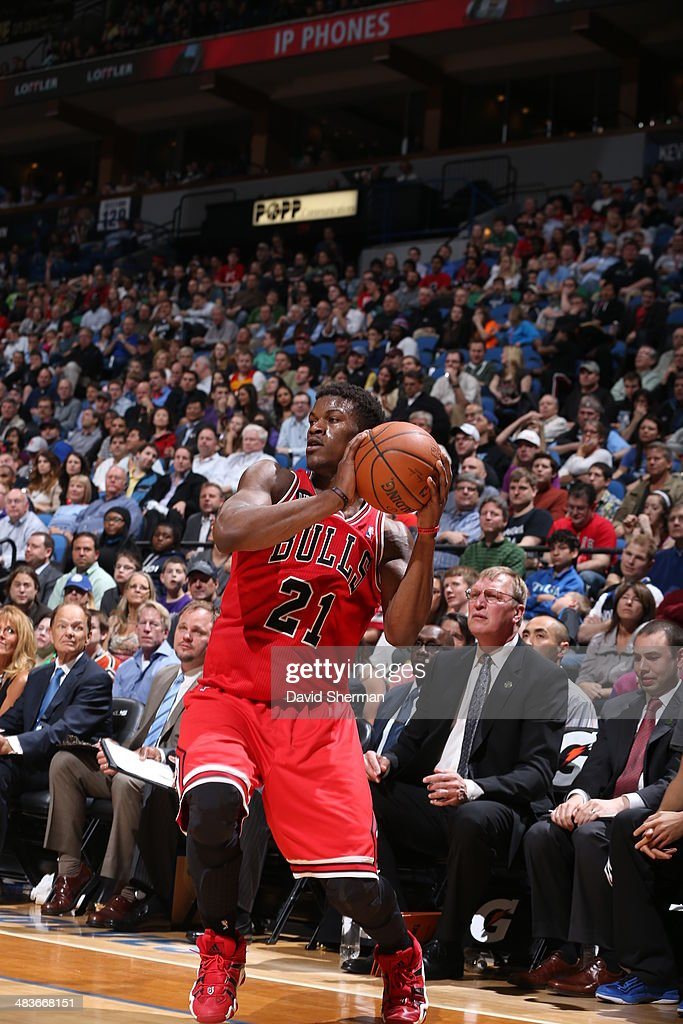Jimmy Butler #21 of the Chicago Bulls shoots the ball against the Minnesota Timberwolves during the game on April 9, 2014 at Target Center in Minneapolis, Minnesota.