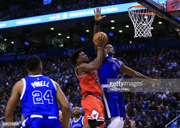Jimmy Butler of the Chicago Bulls shoots the ball as Serge Ibaka of the Toronto Raptors defends during the second half of an NBA game at Air Canada...