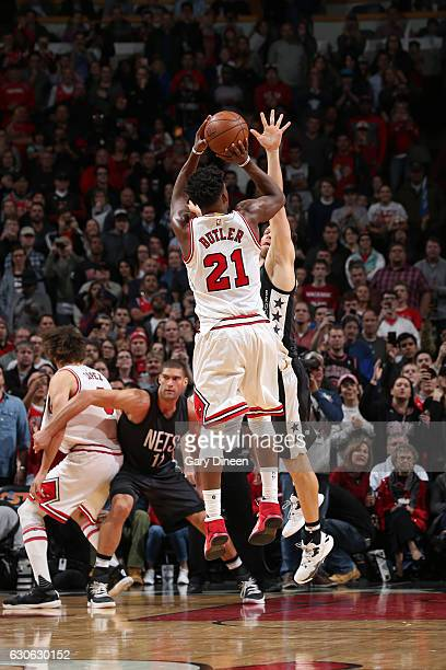 Jimmy Butler of the Chicago Bulls shoots the game winning shot against the Brooklyn Nets on December 28 2016 at the United Center in Chicago Illinois...