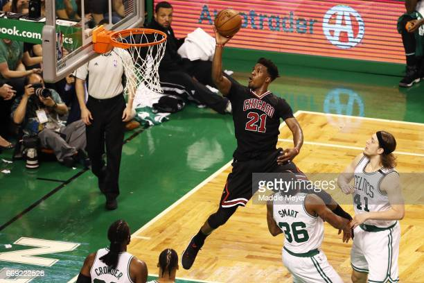 Jimmy Butler of the Chicago Bulls takes a shot against the Boston Celtics during the third quarter of Game One of the Eastern Conference...