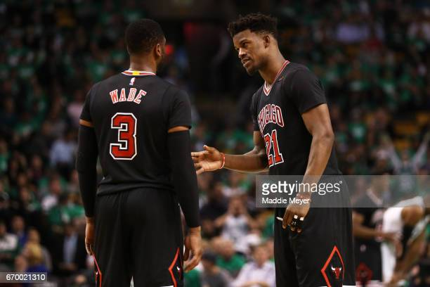 Jimmy Butler of the Chicago Bulls talks with Dwyane Wade during the third quarter of Game Two of the Eastern Conference Quarterfinals against the...