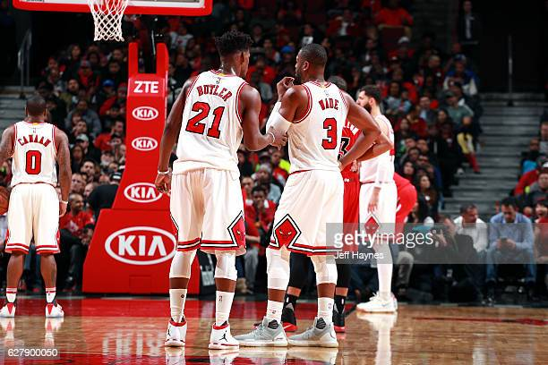 Jimmy Butler of the Chicago Bulls talks with Dwyane Wade of the Chicago Bulls during the game against the Portland Trail Blazers on December 5 2016...