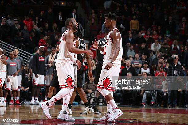 Jimmy Butler of the Chicago Bulls talks with Dwyane Wade of the Chicago Bulls during the game against the San Antonio Spurs at the United Center on...