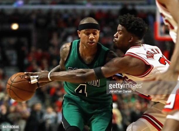 Jimmy Butler of the Chicago Bulls tries to knock the ball away from Isaiah Thomas of the Boston Celtics at the United Center on February 16 2017 in...