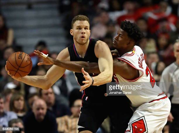 Jimmy Butler of the Chicago Bulls tries to knock the ball away from Blake Griffin of the LA Clippers at the United Center on March 4 2017 in Chicago...