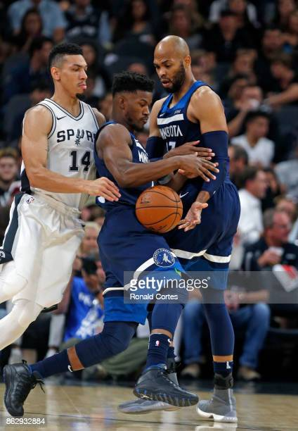 Jimmy Butler of the Minnesota Timberwolves get can the handoff from Taj Gibson of the Minnesota Timberwolves as Danny Green of the San Antonio Spurs...