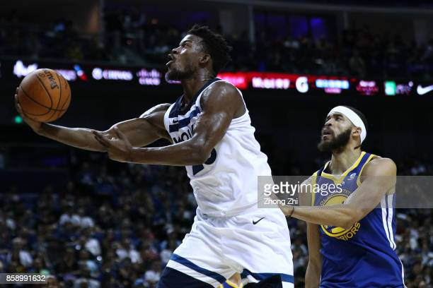 Jimmy Butler of the Minnesota Timberwolves in action against JaVale McGee of the Golden State Warriors during the game between the Minnesota...