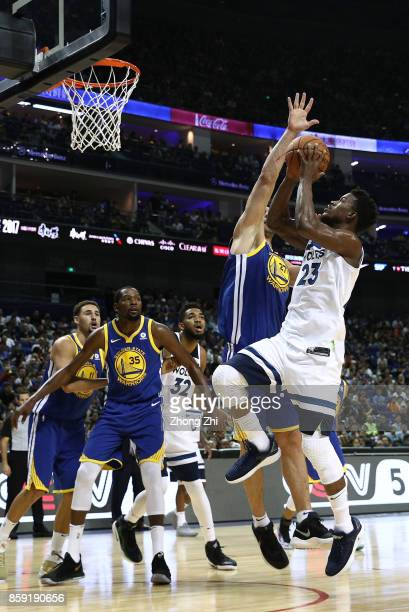 Jimmy Butler of the Minnesota Timberwolves in action agaisnt Zaza Pachulia of the Golden State Warriors during the game between the Minnesota...