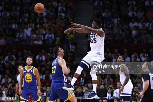 Jimmy Butler of the Minnesota Timberwolves in action agianst Zaza Pachulia the Golden State Warriors during the game between the Minnesota...
