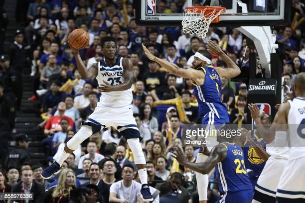 Jimmy Butler of the Minnesota Timberwolves in action JaVale McGee of the Golden State Warriors during the game between the Minnesota Timberwolves and...