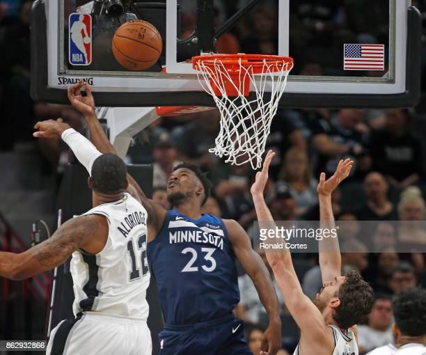 Jimmy Butler of the Minnesota Timberwolves shoots over LaMarcus Aldridge of the San Antonio Spurs at ATT Center on October 18 2017 in San Antonio...