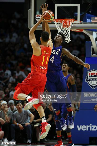Jimmy Butler of the United States blocks a shot against Yi Jianliang of China during the second half of a USA Basketball showcase exhibition game at...