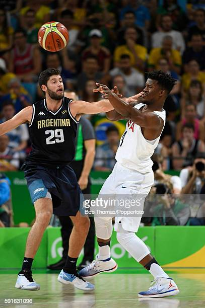 Jimmy Butler of the United States with Patricio Garino of Argentina during the United States v Argentina Men's Quarterfinal match on Day 12 of the...