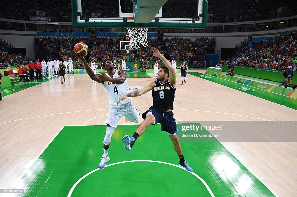 Jimmy Butler of the USA Basketball Men's National Team goes to the basket against Nicolas Laprovittola of Argentina during the Quarterfinals on Day...
