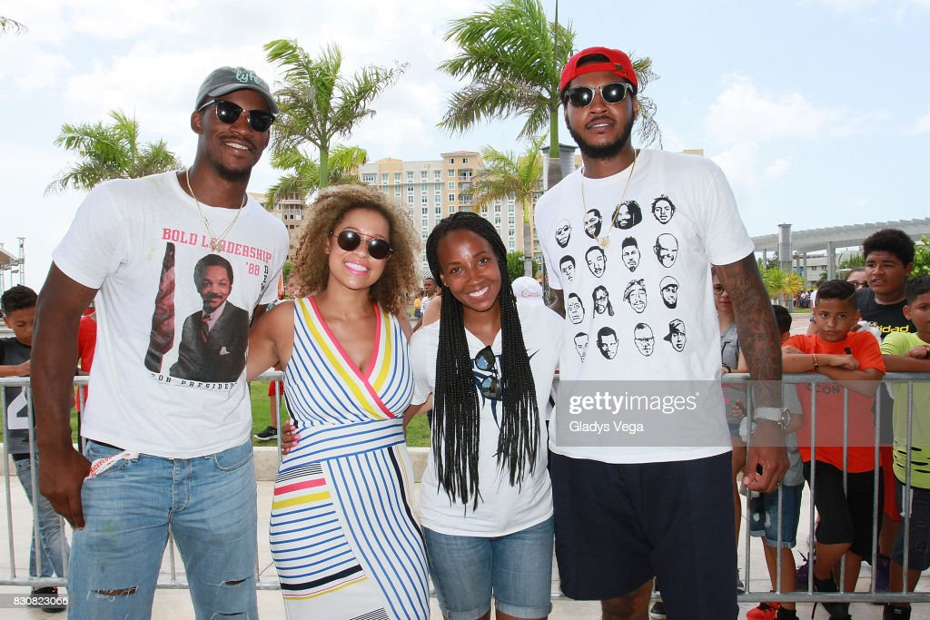 Jimmy Butler, Sydney Cohn, Asani Swann and Carmelo Anthony participate in the Worldwide Day of Play at Bahia Urbana Bay Side Park at Bahai Urbana Bay Side Park on August 12, 2017 in San Juan, Puerto Rico.