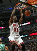 Jimmy Butler the Chicago Bulls dunks against the Boston Celtics at the United Center on January 2 2014 in Chicago Illinois The Bulls defeated the...