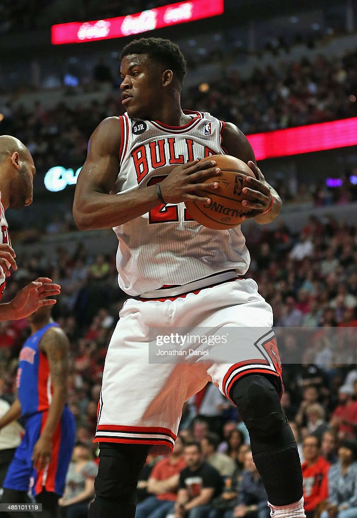 Jimmy Butlker #21 of the Chicago Bulls rebounds against the Detroit Pistons at the United Center on April 11, 2014 in Chicago, Illinois. The Bulls defeated the Pistons 106-98.