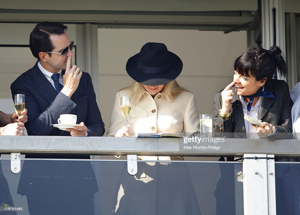 Jimmy Carr (left) and Lily Allen (right) watch the racing as they attends Day 4 of the Cheltenham Festival at Cheltenham Racecourse on March 14, 2014 in Cheltenham, England.