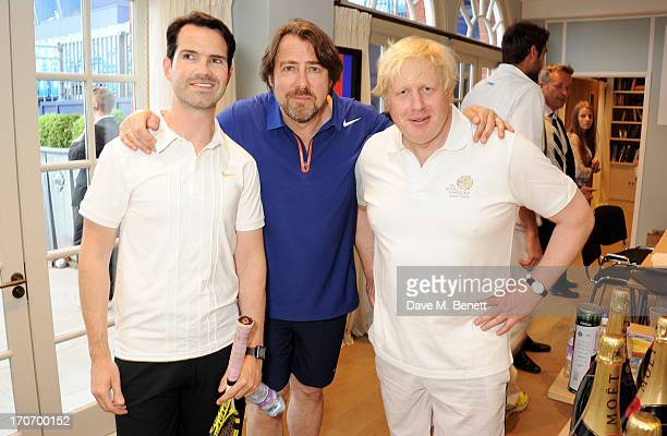 Jimmy Carr Jonathan Ross and Boris Johnson attend The Moet Chandon Suite at The Aegon Championships Queens Club finals on June 16 2013 in London...