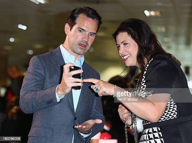 Jimmy Carr speaks to Kirstie Allsopp on the trading floor during the BGC Charity Day 2013 at BGC Partners on September 11 2013 in London England