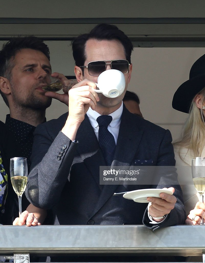 <a gi-track='captionPersonalityLinkClicked' href=/galleries/search?phrase=Jimmy+Carr&family=editorial&specificpeople=211613 ng-click='$event.stopPropagation()'>Jimmy Carr</a> watch the raciong on day 4 of The Cheltenham Festival at Cheltenham Racecourse on March 14, 2014 in Cheltenham, England.