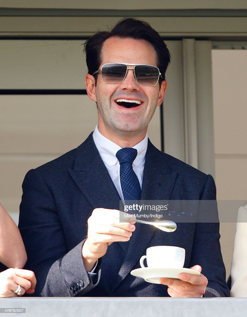 Jimmy Carr watches the racing as he attends Day 4 of the Cheltenham Festival at Cheltenham Racecourse on March 14, 2014 in Cheltenham, England.