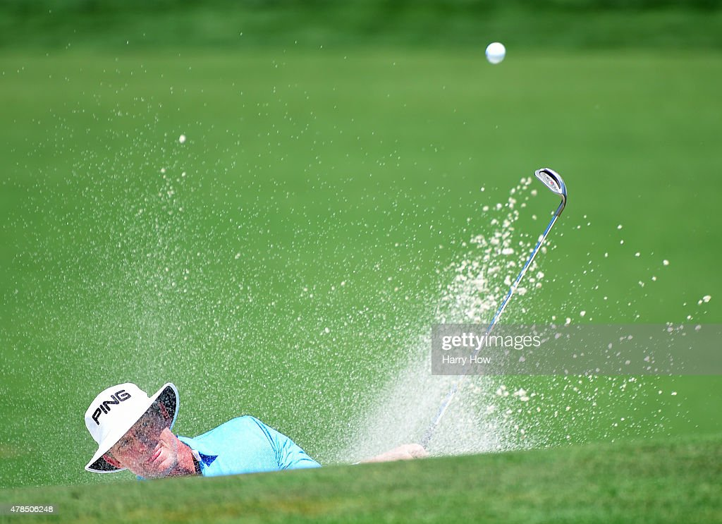 Jimmy Carter hits out of a bunker on the 15th hole during round one of the U.S. Senior Open Championship at the Del Paso Country Club on June 25, 2015 in Sacramento, California.