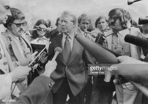 Jimmy Carter is surrounded by Reporters at Airport He said President Ford showed 'lack of leadership' in Earl Butz controversy Credit Denver Post