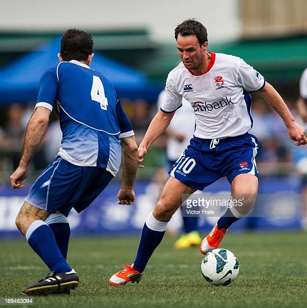 Jimmy Carter of Citibank All Stars and Antony Sassi of HKFC Veterans fight for the ball on day two of the Hong Kong International Soccer Sevens at...