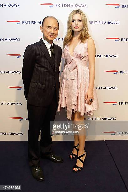 Jimmy Choo and Georgia May Jagger pose for a photo during British Airways Kuala Lumpur launch event on May 28 2015 in Kuala Lumpur Malaysia