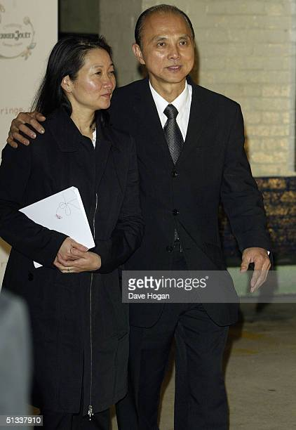 Jimmy Choo and his wife are seen backstage at the Fashion Fringe fashion show as part of London Fashion Week Spring/Summer 2005 at the Selfridges car...