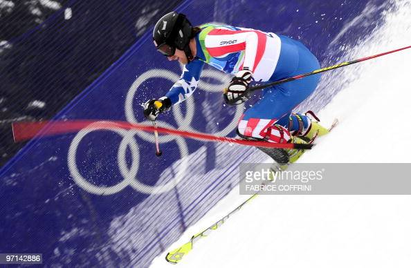US Jimmy Cochran clears a gate during the Men's Vancouver 2010 Winter Olympics Slalom event at Whistler Creek side Alpine skiing venue on February 27...