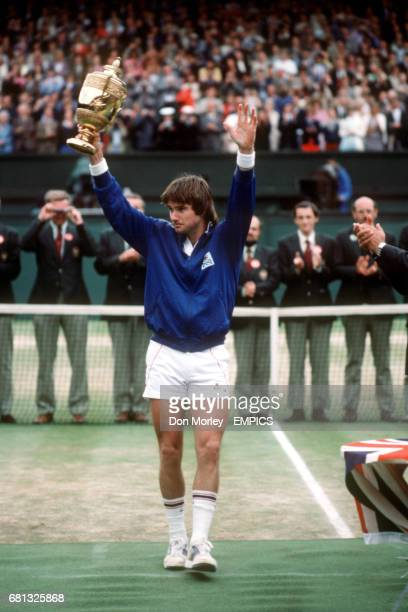 Jimmy Connors shows the trophy off to the crowd on centre court