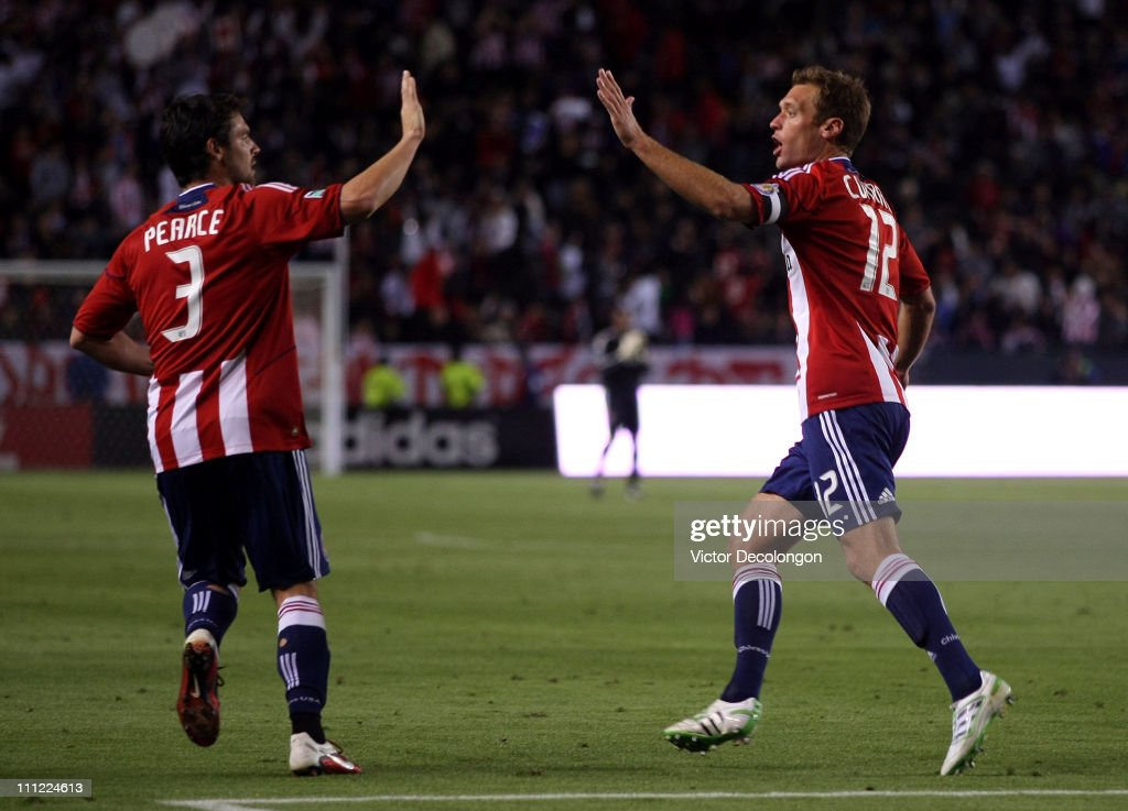 Jimmy Conrad of Chivas USA celebrates his second half goal against Sporting Kansas City with teammate Heath Pearce during the MLS match at The Home...