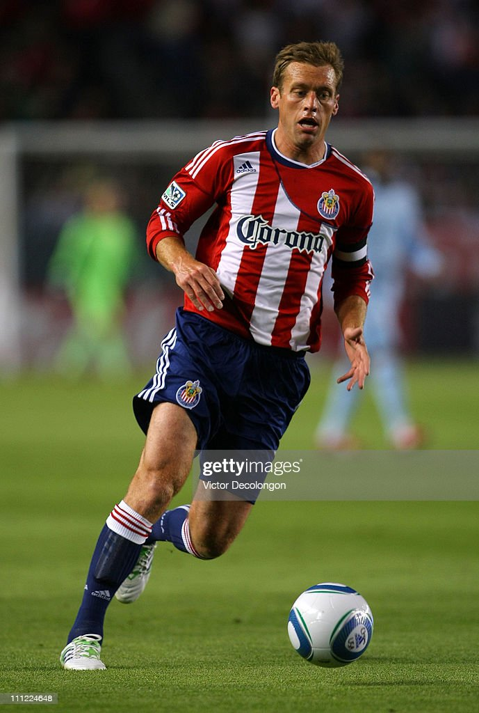 Jimmy Conrad of Chivas USA runs back for the ball during the MLS match against Sporting Kansas City at The Home Depot Center on March 19 2011 in...