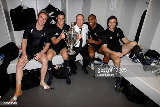 Jimmy Cowan Dan Carter Graham Henry the head coach Joe Rokocoko and Conrad Smith celebrate with the Tri Nations trophy after their victory in the...