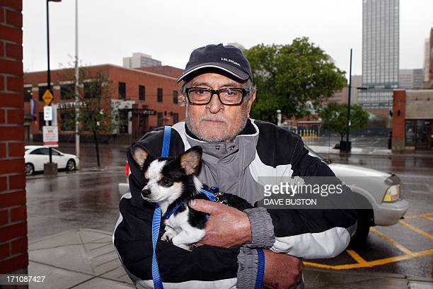 Jimmy Damji and his pet dog Sparky do some shopping for groceries after being evacuated from their home as waters rise in Calgary Alberta Canada June...