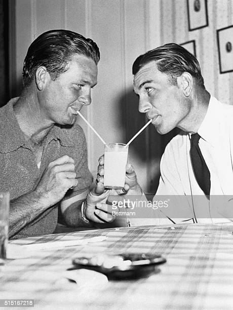 Jimmy Demaret and Ben Hogan share a glass of milk in Augusta Georgia during the Masters Golf Tournament