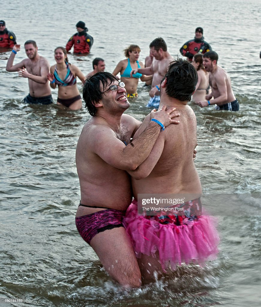 Jimmy DePalmer (L) and Chris Leverenz (R) from Baltimore City take part in the 17th Annual MSP Polar Bear Plunge in the Chesapeake Bay at Sandy Point State Park on Saturday, January 26, 2013.