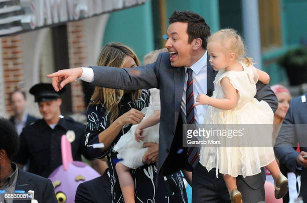 Jimmy Fallon and her daugther Frances greet the audience during the Grand Opening of Universal Orlando's Newest Attraction 'Race Through New York...