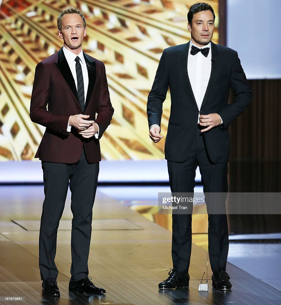 Jimmy Fallon (R) and host <a gi-track='captionPersonalityLinkClicked' href=/galleries/search?phrase=Neil+Patrick+Harris&family=editorial&specificpeople=210509 ng-click='$event.stopPropagation()'>Neil Patrick Harris</a> speak onstage during the 65th Annual Primetime Emmy Awards held at Nokia Theatre L.A. Live on September 22, 2013 in Los Angeles, California.