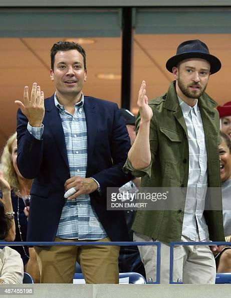 Jimmy Fallon and Justin Timberlake dance during a break in the match between Richard Gasquet of France and Roger Federer of Switzerland during their...