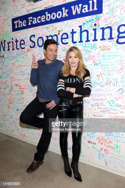 Jimmy Fallon and Madonna pose at the Facebook wall before their livestream interview at the Facebook offices on March 24 2012 in New York City