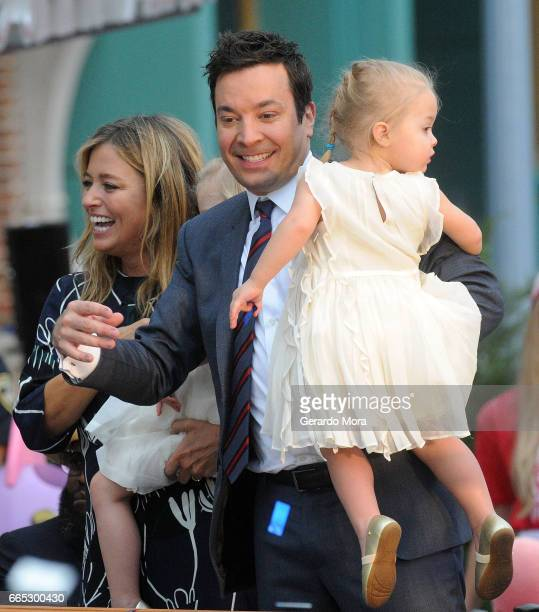 Jimmy Fallon his wife Nancy Juvonen and daugther Frances greet the audience during the Grand Opening of Universal Orlando's Newest Attraction 'Race...